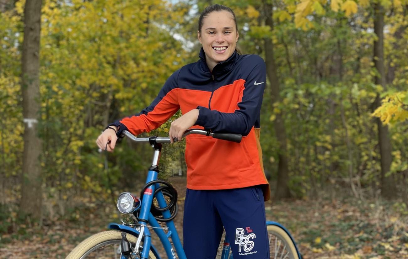 Polish footballer Ewa Pajor trains on a bike in Wolfsburg